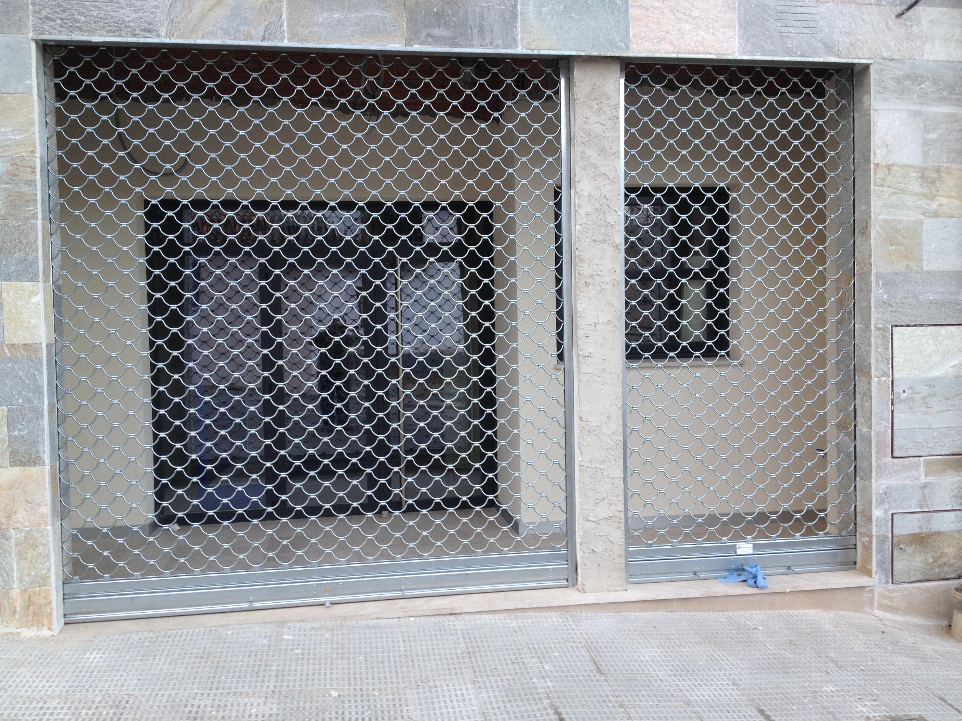 Persianas met licas puertas arriazu - Puertas de persiana ...