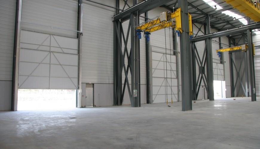 Puertas industriales de guillotina puertas arriazu for Puertas industriales